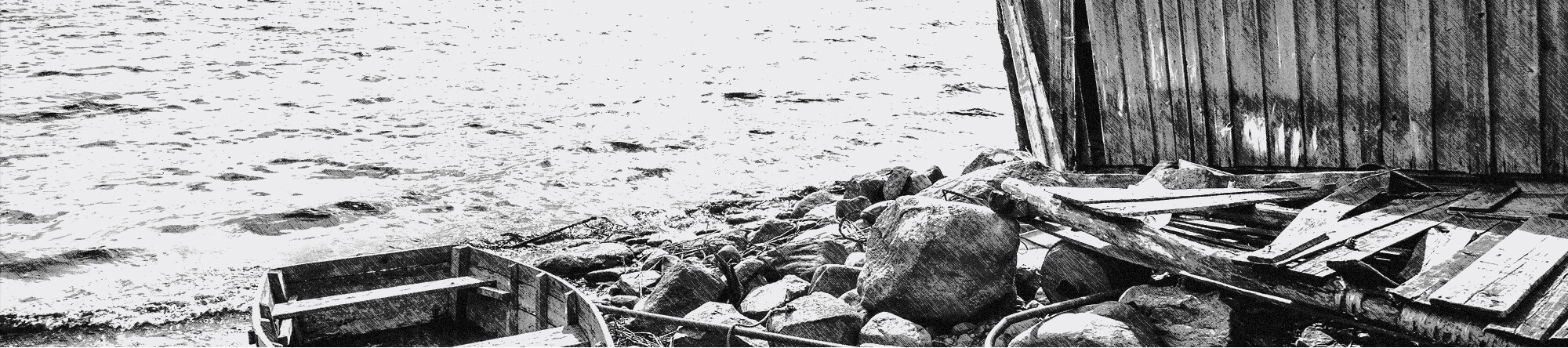 Dry Dock 28 black and white rocky shoreline with boat
