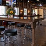 large high bar and bar stools