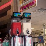 two frozen drink machines at a bar